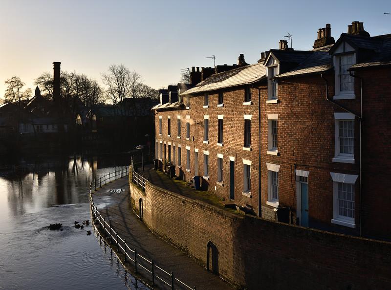 Terraced houses beside the river Severn, English Bridge, Shrewsbury.