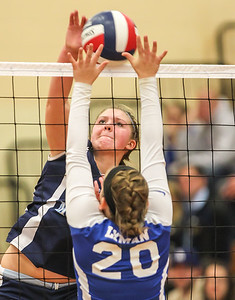 class S Volleyball MVP Jen Dawson Gies up for her one of 25 kills against Lyman Memorial to lead her Huskies to their first State title in 5 years