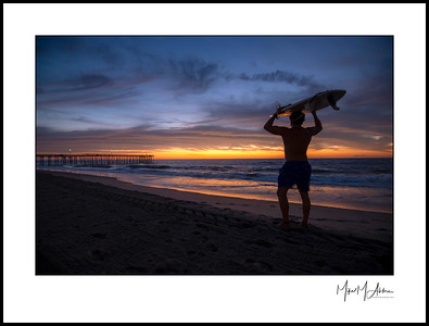 Every day is a gift. Some arrive gift wrapped. Surfer Kyle Muller enjoys first light at Ocean City, MD.