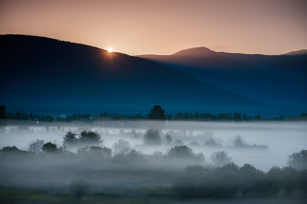 Sunrise and fog over Creston Valley, BC, Canada