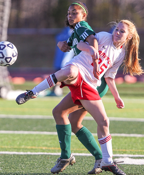 Guiford Indian Kyera Bryant and Branford Hornet Jessica O'Connor battle for ball possesion during the Class L Girls state soccer final. The Indians were victorious in their bid for the state crwon defeating branford 2-0.