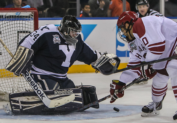 Yale goaltender Alex Lyon makes a save off the shot of Harvard Forward Brayden Jaw during the Saturday Night game at Madison Square Garden