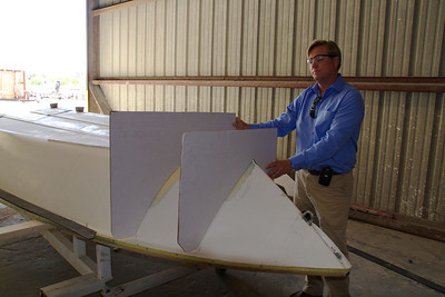 George is holding a couple of the templates that will be used to guide the reshaping of the hull.