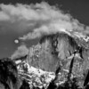 """Half dome""<br /> <br /> The cloud covered dome, and the rising moon added an interesting Ansel Adams touch."