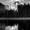 """Pensive reflection""<br /> <br /> A lingering cloud and moon above half dome, captured in Ansel Adams style."