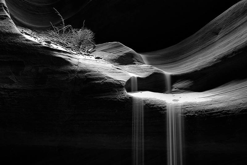 """""""Spot-lit sand falls""""<br /> <br /> Had to run back and forth to throw the sand and come take the picture. Some good lighting also helped this scene in Antelope canyon."""
