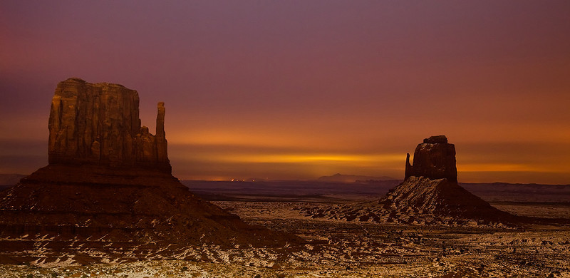 """Navajo night lights""<br /> <br /> A 12min exposure on very freezing windy night at monument valley. The light in the back is from the city of Mexican hat."