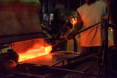 Feeding molten glass into the rollers