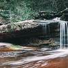 Bushland oasis - a waterfall on Sydney's northern fringe comes to life after heavy recent rainfall