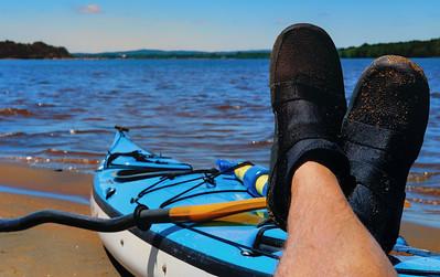Kicking Back. Senior male taking a paddling break on the Ottawa River. Self portrait