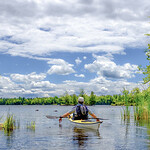 Senior man taking a paddling break on the Ottawa River