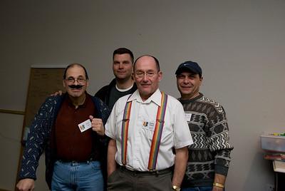 The company men: Papa Vito, Ralph Rottingrape, Otto Von Schnapps, and Bud Wizer.