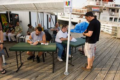 Dockside. Paul's making name tags for everyone, and I'll sit with Tom selling tickets.