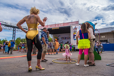 Bryan Syltie, 2, waves to another Tour de Fat participant on Saturday, September 1, 2018, during the Tour de Fat at the New Belgium Brewery in Fort Collins, Colo.