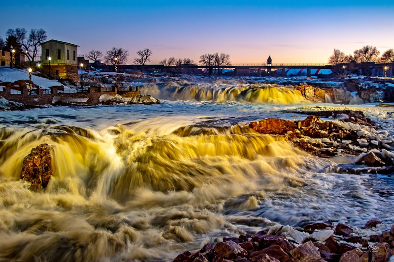 The area around Sioux Falls had experienced a great deal of flooding. This image was taken the day after the worst of the flooding. You can see how full the river is and all the ice chunks deposited around the banks. ⚜�📷<br /> <br /> Enjoy and hold hands.