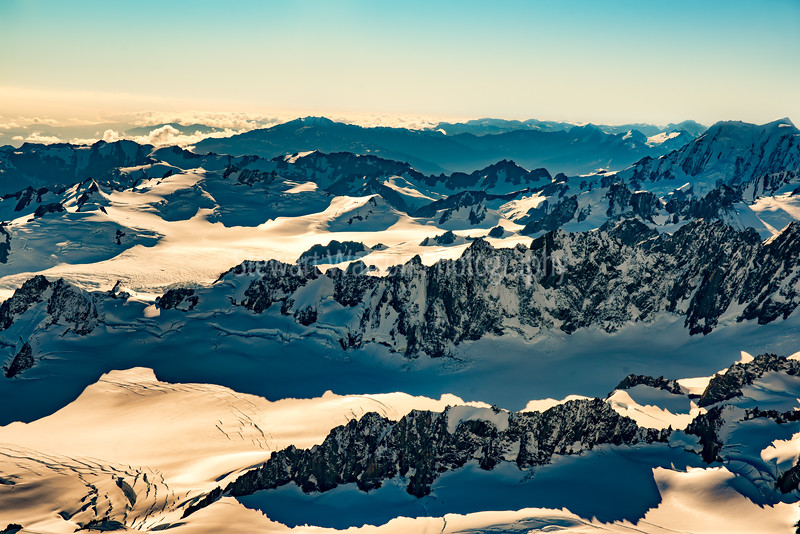Looking down at the vastness of the snow covered New Zealand Southern Alps from a Helicopter