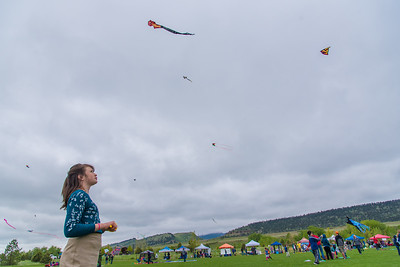 Adalai Parsons, 12, flies her kite at the Kites in the Park Festival on Sunday, May 20, 2018, in Spring Canyon Community Park.