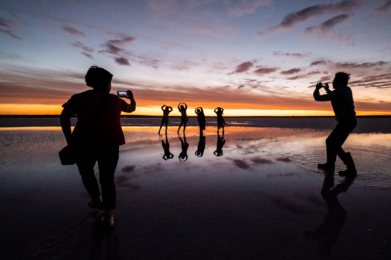 Chinese tourists perform at sunset on Lake Tyrrell, Sea Lake, Victoria