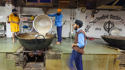 Gurudwara Bangla Sahib, Kitchen  The most prominent Sikh Gurdwara, or Sikh house of worship, in Delhi. The grounds include the temple, a kitchen, a large pond, a school and an art gallery. As with all Sikh Gurdwaras, the concept of langar is practiced, and all people, regardless of race or religion may eat in the Gurdwara kitchen (langar hall). The Langar (food) is prepared by Gursikhs who work there and also by volunteers who like to help out.  It was noted 40,000 to 50,000 people share a meal each day.
