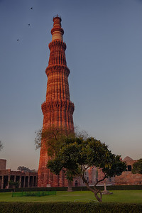 It is 72.5 metres (237.8 ft) high and has a base diameter of 14.3 metres, which narrows to 2.7 metres at the last storey. Construction began in 1192 by Qutub-ud-din Aibak and was completed by Iltutmish. It is surrounded by several other ancient and medieval structures and ruins, collectively known as the Qutub complex.[1][6] Tradition assigns the erection of the pillar to Anang Pal, whose name it bears, with the date 1052 C.E. The Qutub Minar is made of fluted red sandstone covered with intricate carvings and verses from the Qur'an. Numerous inscriptions in Parso-Arabic and Nagari characters in different sections of the Qutub Minar reveal the history of Qutb. According to the inscriptions on its surface it was repaired by Firoz Shah Tughluq (AD 1351-88) and Sikandar Lodi[8] (AD 1489-1517). It is a UNESCO World Heritage Site.