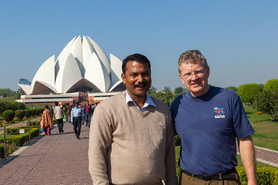 With Dr. Manish Srivastav at the Lotus Temple, located in New Delhi, India. It is a Bahá'í House of Worship completed in 1986. Notable for its flowerlike shape, it serves as the Mother Temple of the Indian subcontinent and has become a prominent attraction in the city. The Lotus Temple has won numerous architectural awards and been featured in hundreds of newspaper and magazine articles. Like all other Bahá'í Houses of Worship, the Lotus Temple is open to all regardless of religion, or any other distinction, as emphasized in Bahá'í texts. The Bahá'í laws emphasize that the spirit of the House of Worship be that it is a gathering place where people of all religions may worship God without denominational restrictions.