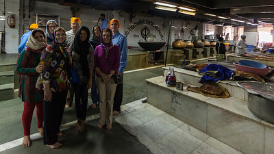 Publisher Group at Gurudwara Bangla Sahib, Kitchen  The most prominent Sikh Gurdwara, or Sikh house of worship, in Delhi. The grounds include the temple, a kitchen, a large pond, a school and an art gallery. As with all Sikh Gurdwaras, the concept of langar is practiced, and all people, regardless of race or religion may eat in the Gurdwara kitchen (langar hall). The Langar (food) is prepared by Gursikhs who work there and also by volunteers who like to help out.  It was noted 40,000 to 50,000 people share a meal each day.