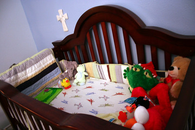 The crib was a gift from grandma and grandpa Guerra. :) And Jackie gave us the cross. (she has a nice collection, herself).