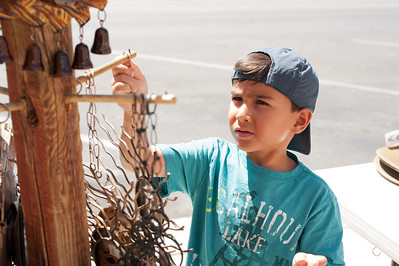 Ryan was entranced by the wind chimes being sold by a street vendor in Boulder NV.
