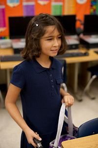 Picking out her seat in her new classroom.