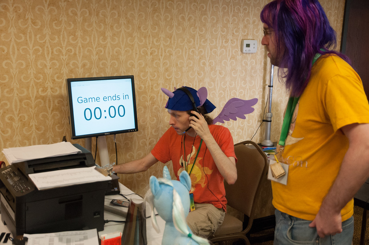 In this room these Bronies were live stream casting a  MLP card game that was taking place. Apparently people watch it.