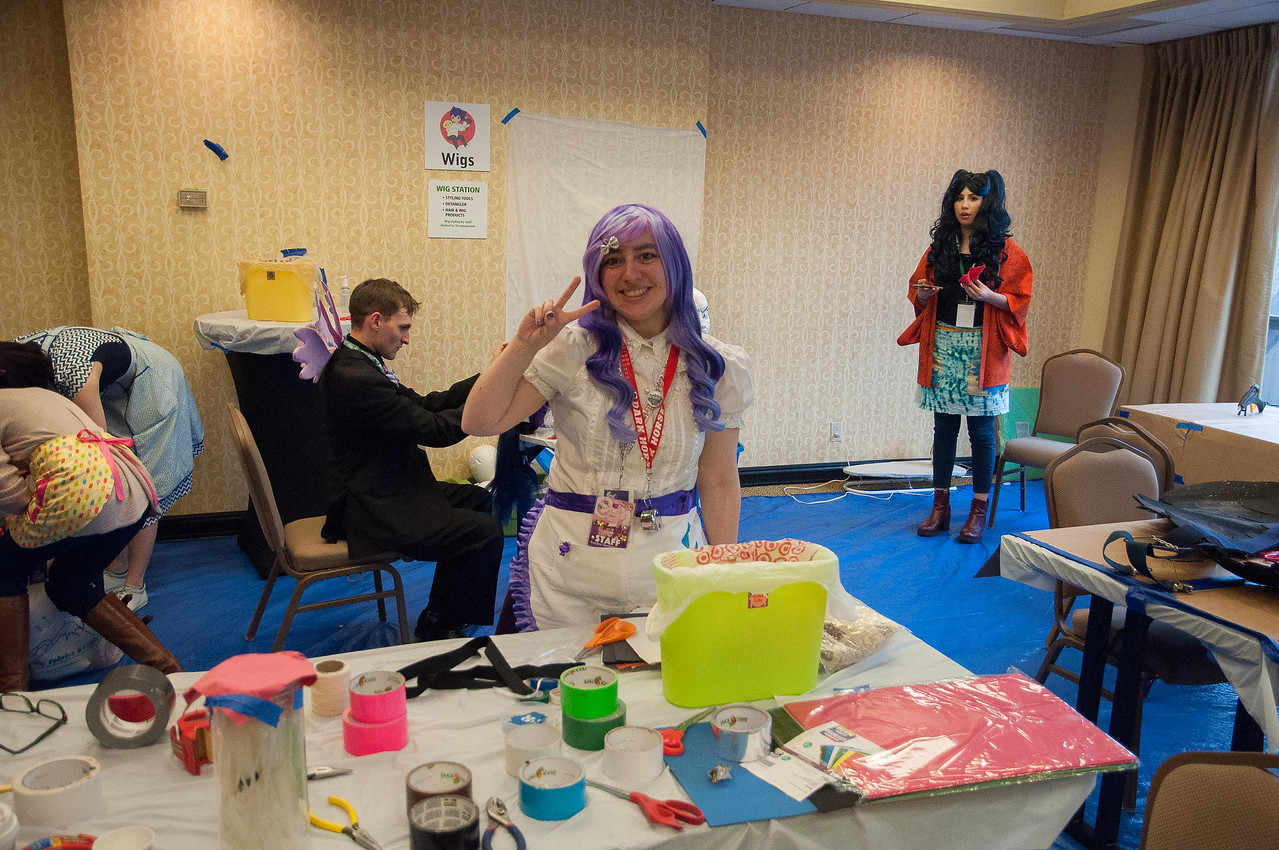 """This is the Cosplay Repair Room. Of course with so many costumes, repairs are always needed and this room is where it happens. This woman and her Cosplay Repair group perform the repair function at several different """"Cons""""."""