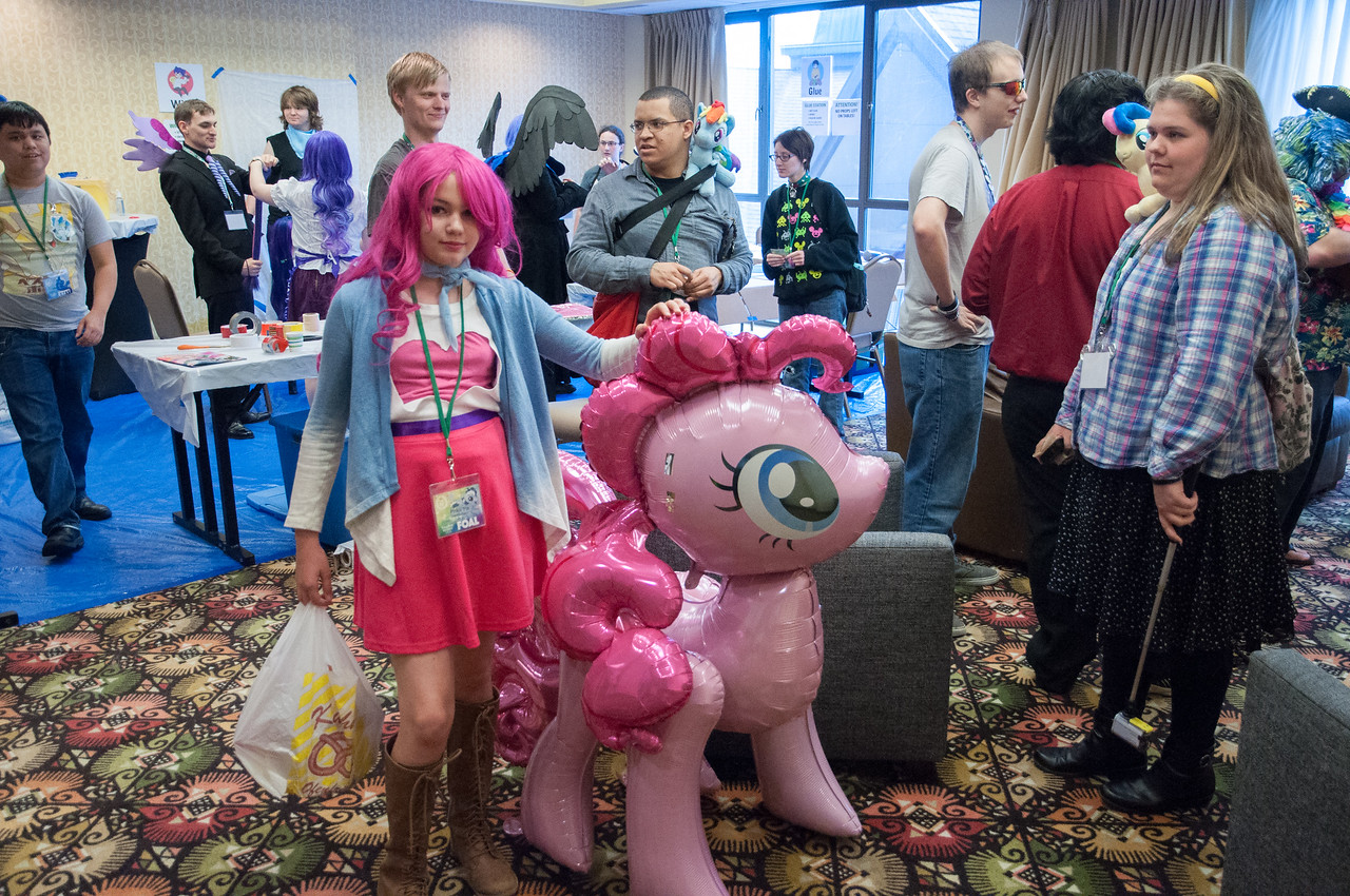 Sorchia, a.k.a. Pinkie Pie, posing with Pinkie Pie in the Cosplay Repair Room.
