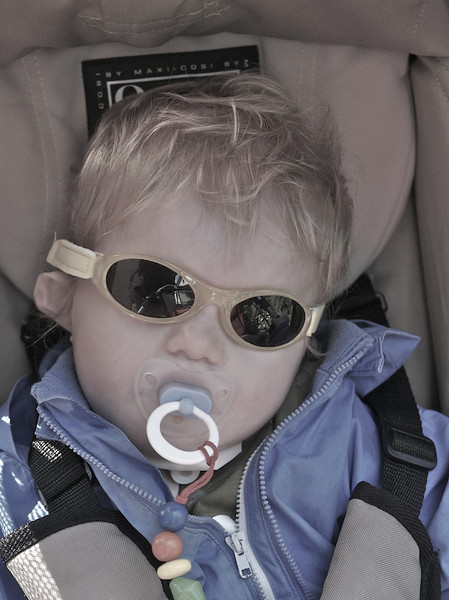 Monday 14th may 2007 - Eventually we manage to persuade Cai that he looks cool in shades.  He cried the first few time we tried, but as he can't blink or close his eyelids properly he needs to protect himself from the sun