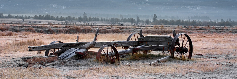This old farm wagon is located across the cascade airport from the highway. It is long gone now. There use to be an old barn that stood there that was torn down and a new home was built there. I can only believe that this old wagon went with it. Kind of funny though, as I crossed the airport runway to get to this old homestead I looked both ways as expected before crossing. Then I thought, I better look up too. Don't want to get hit by any planes. Anyway this was a frosty morning. I was quite, except for the Payette behind me rumbling over the rocks.
