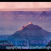 The early morning sun strikes a rock formation in the Grand Canyon, as seen from the North Rim in Arizona; detail in this image is best viewed in a larger size