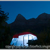 A lighted tent glows in the darkness of Zion National Park