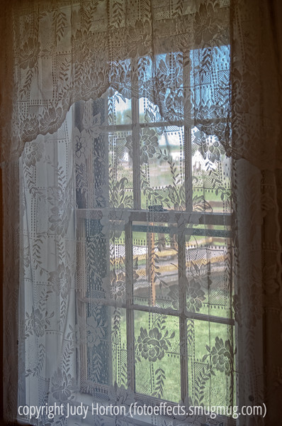 Window with lace curtain; best viewed in the largest sizes