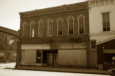 Former Dick's Furniture building.  Most recently a church and 'big time rastlin' studio.  Burnt out and empty.