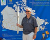 Huntsville 2009 - Holding Olympic torch at fund raising display. Torch on it's way across Canada and back to Vancouver