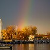 Rainbow<br /> It rained on and off all day with the sun breaking though a lot. I missed 2 rainbows this morning but got lucky enough to get this one at sunset in Rouses Point, NY touching down over the marina.