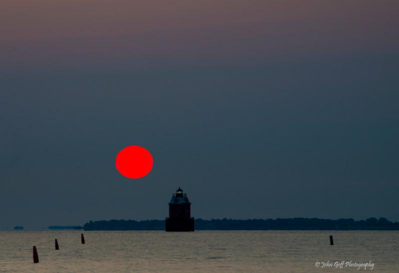 Sun Over The Lighthouse<br /> Sun Rise Sandy Point State Park<br /> Maryland
