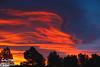 It started as an orange glow on a darkened cloud . . .