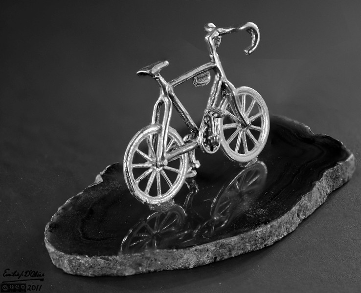 The common theme with all these photographs is Macro photography.  Well, almost.  This bicycle is about 3/4 of an inch tall, with the base maybe around three inches long.<br /> <br /> This is the Black & White treatment of the color original.
