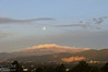 Plus, the clouds below the moon were likely to obscure the moon actually setting atop Pikes Peak.