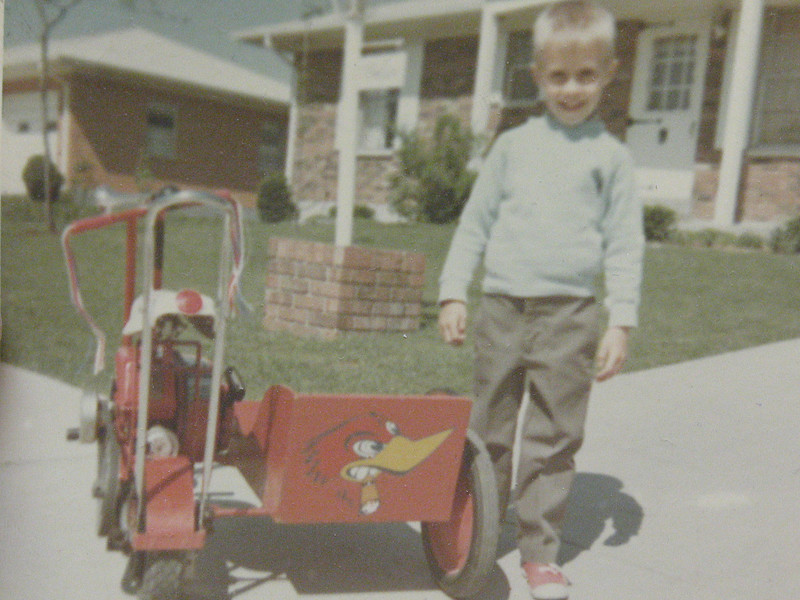 My Dad rode me around in the sidecar of this very early 60's mini he built! Banana seat, sissy bar, handmade sidecar with Clay Smith Cams Peckerhead logo, Clinton single-lunger motor.  Way kool!  (Look, I've even got my trademark Converse on!  Of course, they could be Red Ball Jets too!)