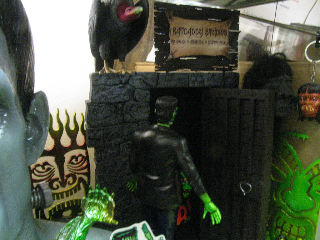 Frankenstein meets Rat Fink.  An illuminated diorama I did with lots of LED and fiber optics lighting to bring it to life!  Some of my airbrushed metal work is in the background.