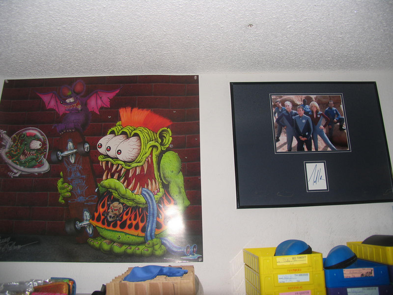 Lots of personalized Sonny DePalma posters on the walls, and an autographed photo of the Galaxy Quest crew by Tim Allen!