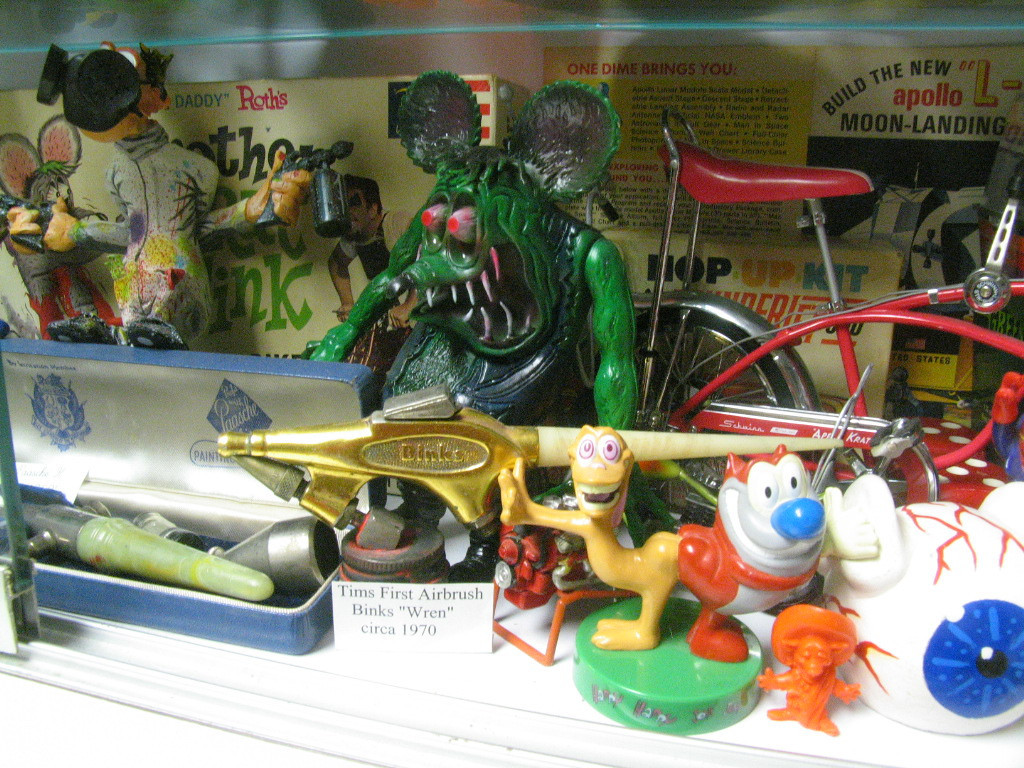 "That's my very first airbrush sitting on the front row!  A Binks ""Wren"" circa 1970!  Very rare ""Brother Rat Fink"" in background."