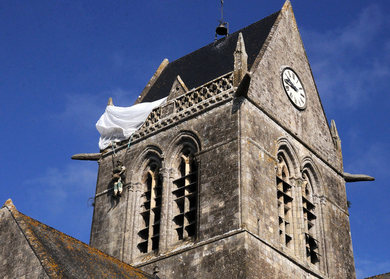 Church steeple and effigy of John Steele; Sainte Mere-Eglise, Normandy, France