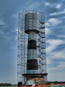 Bodie Island Lighthouse is under repair and still looks pretty amazing. Cape Hatteras National Seashore, NC  http://www.nps.gov/caha/index.htm